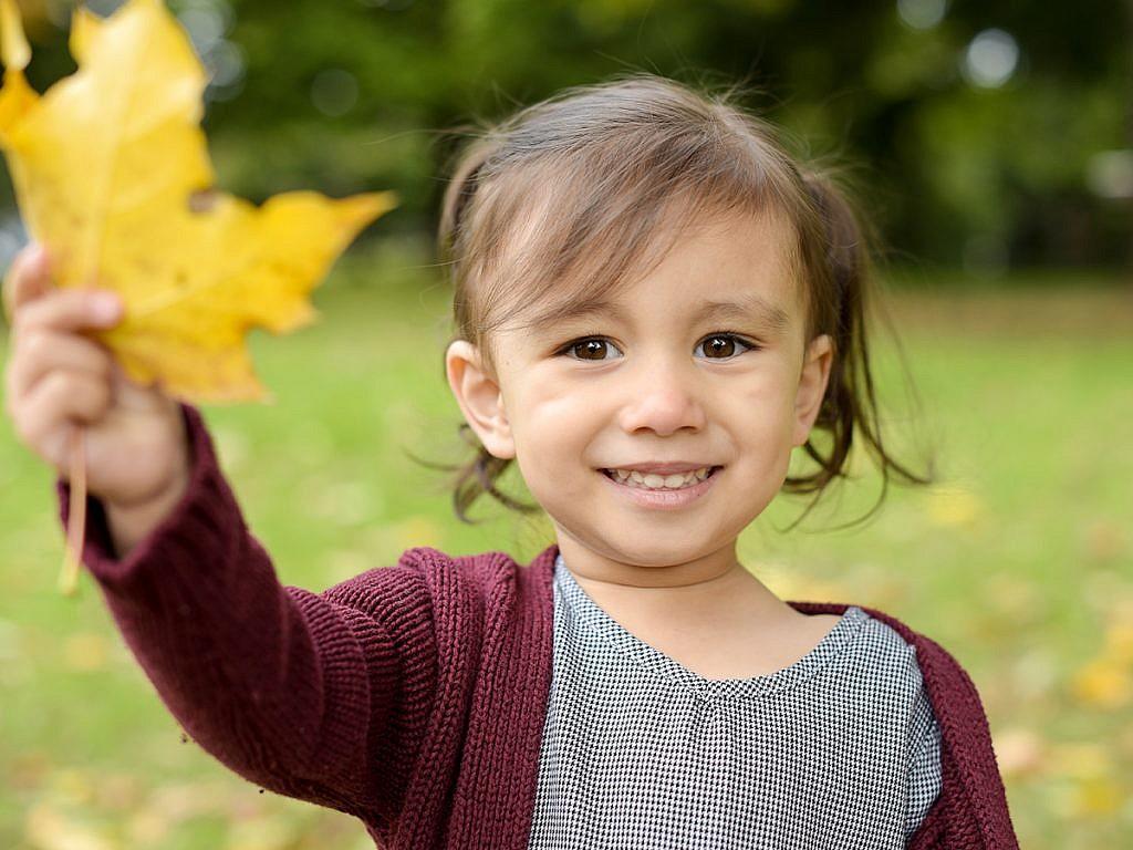 cute kid with a leaf family portraits Anna Graf Photography