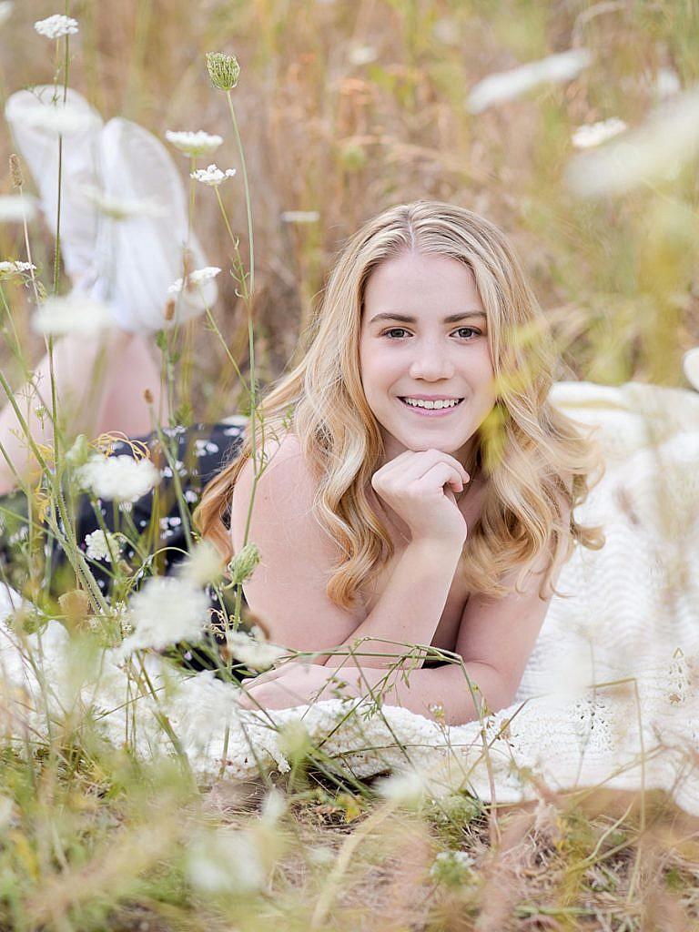 girl-senior-picture-wildflower-field-floral-dress-boho-senior-pic-portland